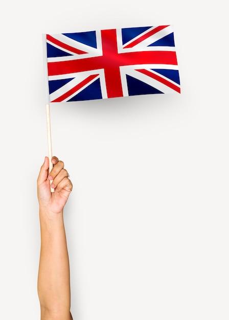 Pessoa, waving, a, bandeira, de, reino unido, de, grã bretanha, e, irlanda norte Psd Premium