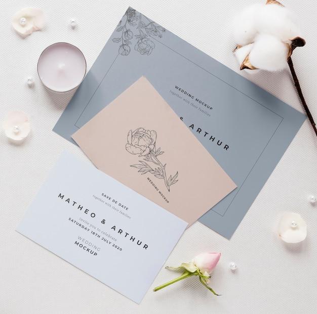 Postura de gordura de cartões de casamento com algodão e velas Psd grátis