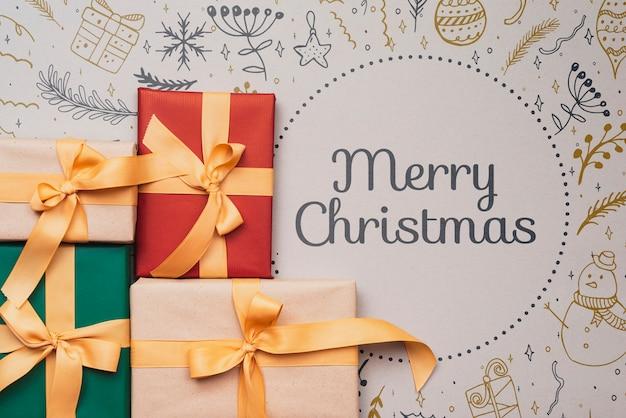Postura plana de maquete de presentes de natal colorido Psd grátis