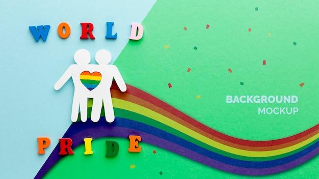 Postura plana do arco-íris por orgulho com coração e pessoas Psd grátis