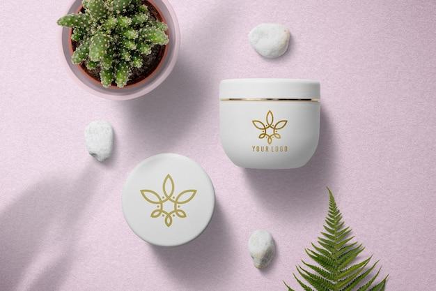 Projeto da maquete do logotipo do frasco de creme para cosméticos Psd Premium