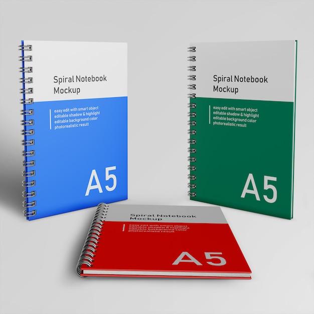 Pronto para usar três capa dura corporativa spiral binder notepad mock ups design modelos em pé e descansando na frente vista em perspectiva Psd Premium
