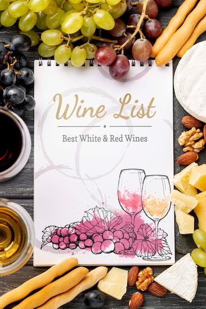 Quadro de garrafas de vinho com notebook Psd grátis