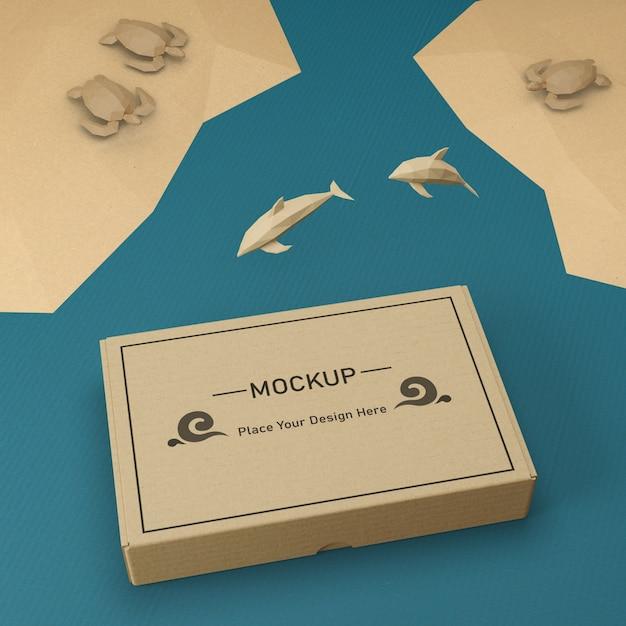 Saco de papel kraft e golfinhos com maquete Psd Premium