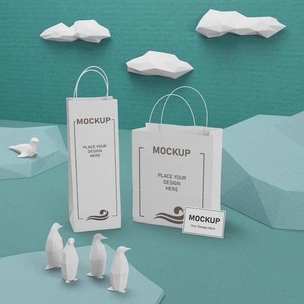 Sacos de papel do dia do oceano com maquete Psd grátis