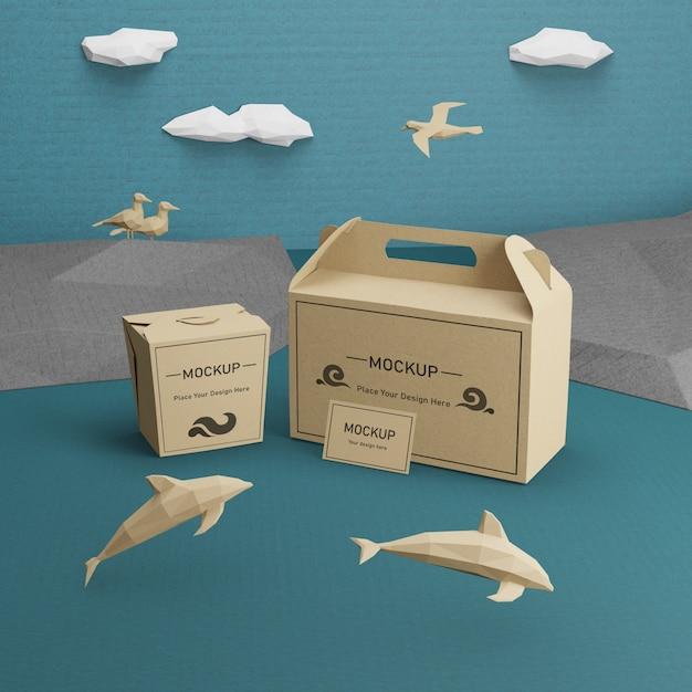 Sacos de papel kraft com maquete de golfinhos Psd grátis