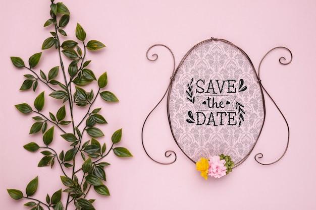 Salve a data vintage mock-up quadro com flores e folhas Psd grátis
