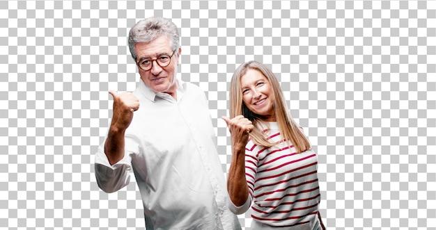 Senior legal marido e mulher com um olhar satisfeito, orgulhoso e feliz com polegares para cima Psd Premium