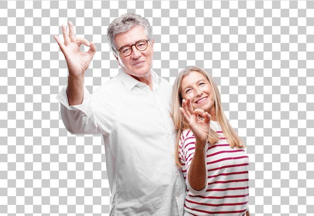 Senior legal marido e mulher fazendo um sinal de tudo bem Psd Premium