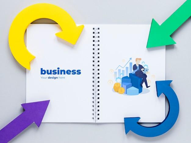 Setas curvas e caderno de negócios Psd grátis