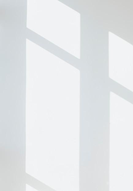 Sombra de uma janela em uma parede branca Psd grátis