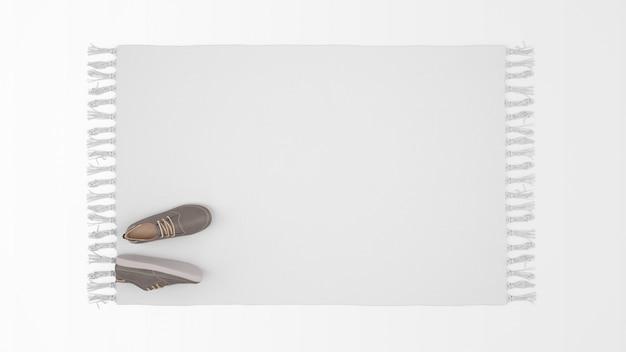 Tapete branco realista com um par de sapatos na vista superior Psd grátis