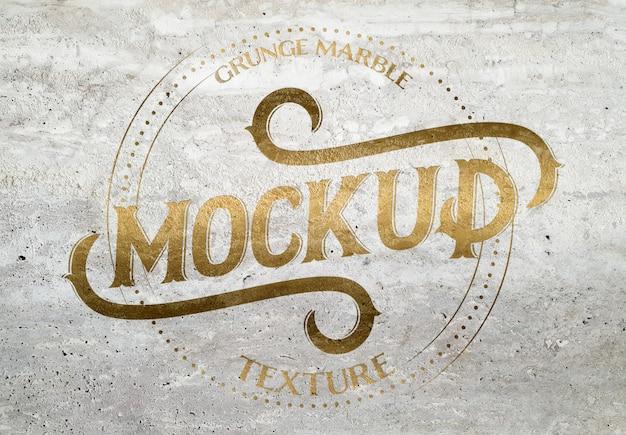 Textura de mármore grunge com efeito chanfrado dourado mockup Psd Premium