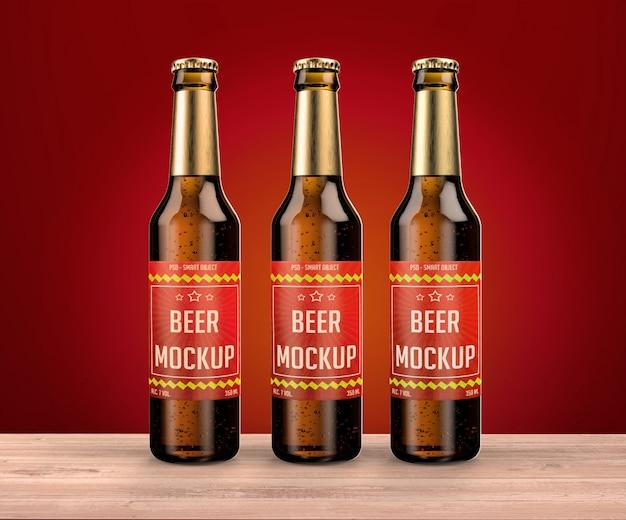 Três garrafas na maquete de mesa Psd Premium