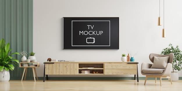 Tv na parede branca da sala de estar com poltrona, design minimalista, renderização em 3d Psd Premium
