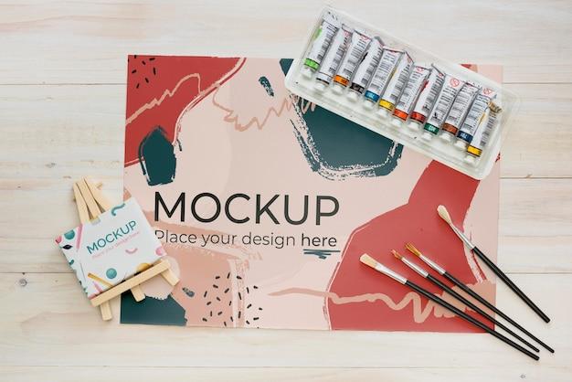 Variedade de conceito de artista plana com maquete de papel Psd Premium