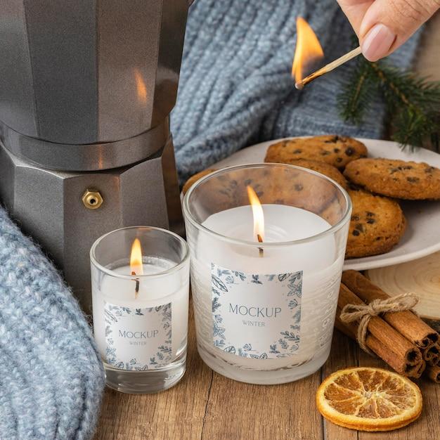 Variedade higiênica de inverno com maquete de velas Psd grátis