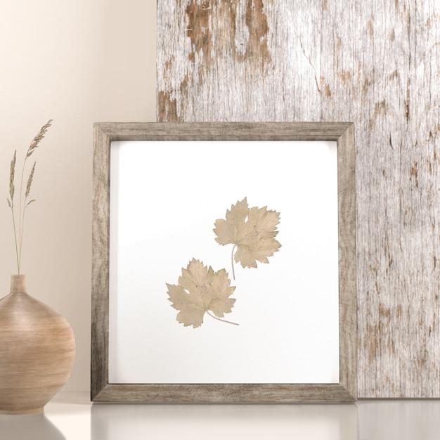 Vista frontal da decoração do quadro com folhas e vaso Psd Premium