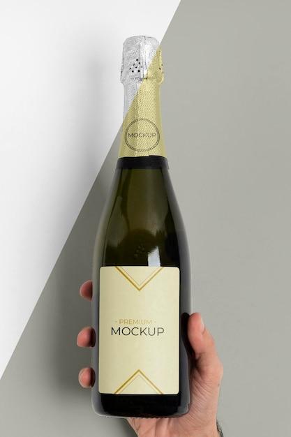 Vista frontal da maquete da garrafa de champanhe Psd grátis