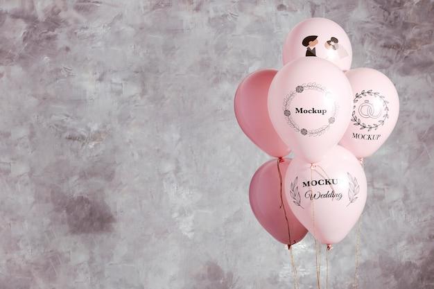 Vista frontal da maquete de balões de casamento Psd grátis