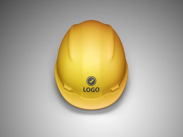 Vista frontal da maquete do logotipo do capacete de construção Psd Premium