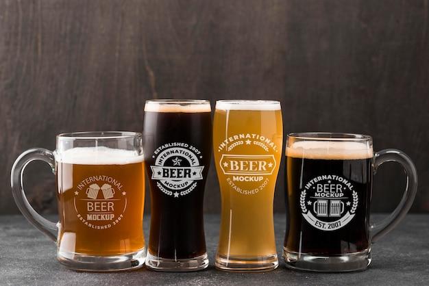 Vista frontal de copos de cerveja e canecas Psd Premium