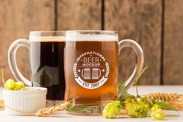 Vista frontal de dois barris de cerveja com cevada Psd grátis