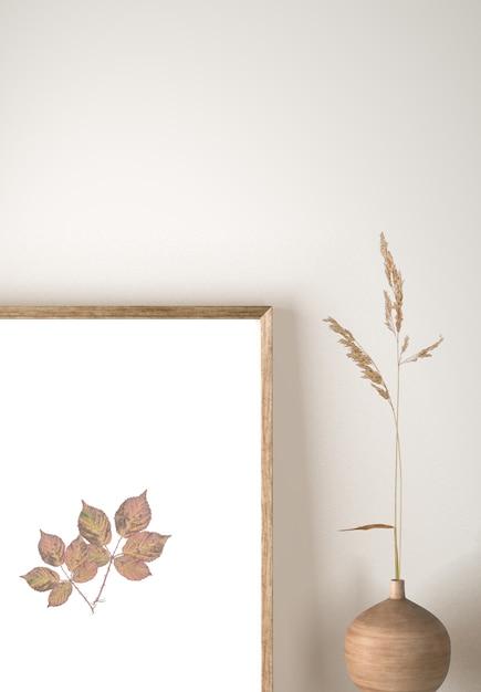 Vista frontal do vaso com flores e decoração de moldura Psd grátis