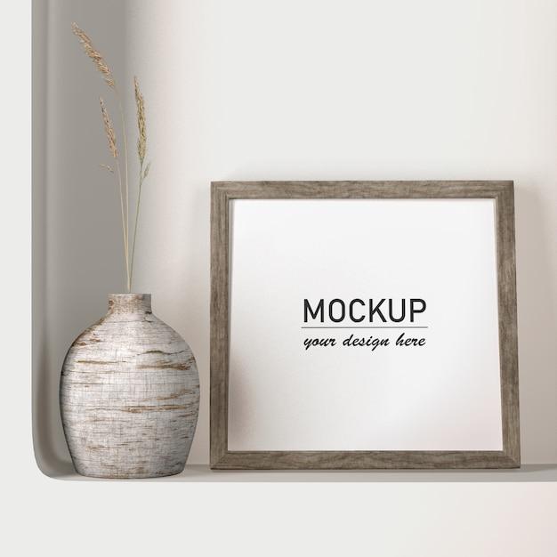 Vista frontal mock-up frame com decoração de vaso Psd grátis