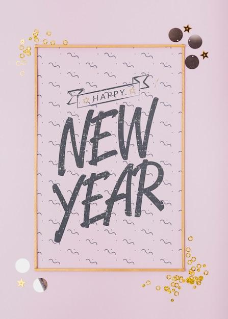Vista superior ano novo letras na moldura dourada mínima Psd grátis