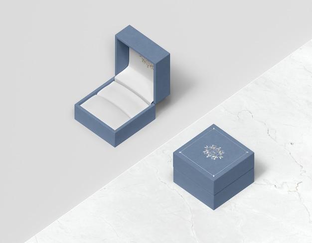 Vista superior caixa de presente azul com capa Psd grátis