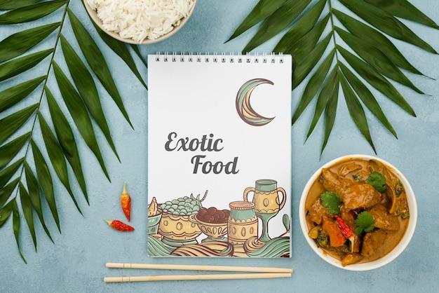 Vista superior conceito de comida exótica com maquete Psd grátis