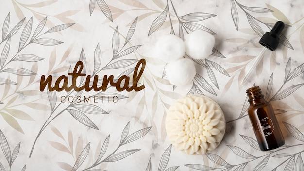Vista superior de cosméticos naturais com óleo essencial e sabão Psd grátis