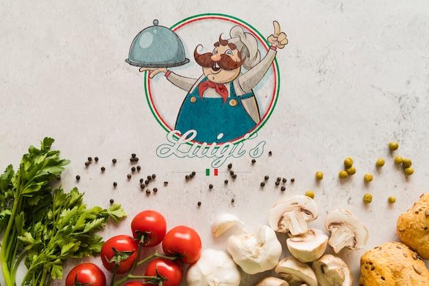 Vista superior de ingredientes de comida italiana com logotipo Psd grátis