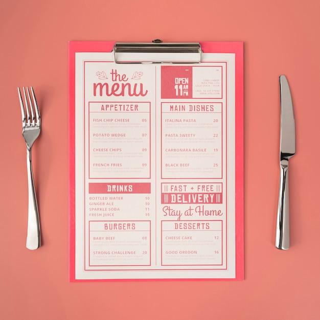 Vista superior do menu com garfo e faca Psd grátis
