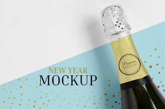 Vista superior do mock-up da garrafa de champanhe Psd grátis