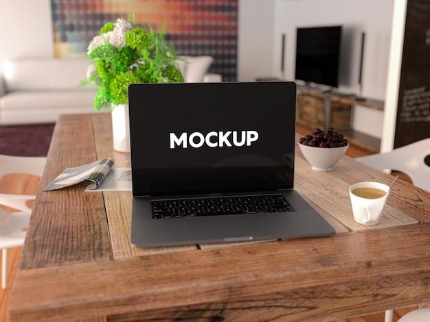 Laptop auf einem Tisch mock up Design Kostenlose PSD