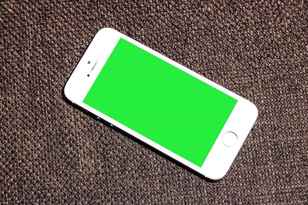 Mobile Green Screen mit braunem Hintergrund Kostenlose PSD