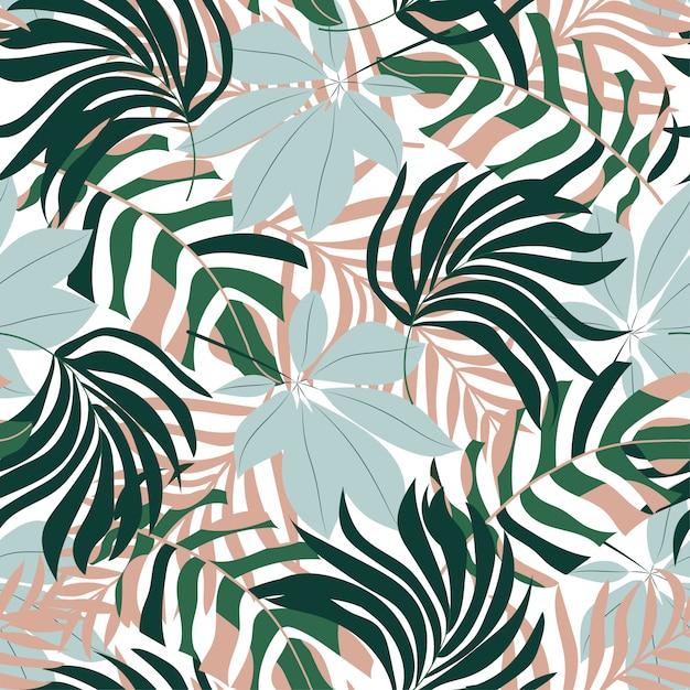 Abstrait modèle sans couture avec des feuilles tropicales colorées et des plantes sur fond clair Vecteur Premium