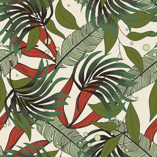 Abstrait modèle sans couture avec des feuilles tropicales colorées et des plantes sur un fond délicat Vecteur Premium