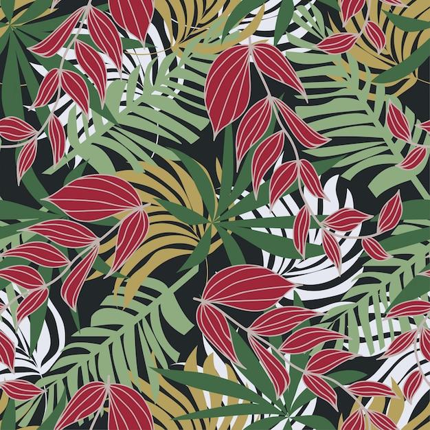 Abstrait modèle sans couture avec des feuilles tropicales colorées et des plantes sur fond gris Vecteur Premium