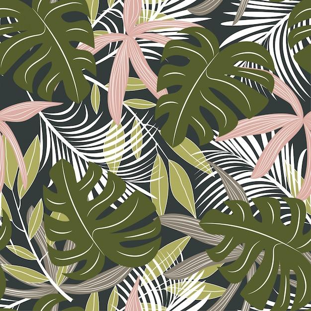 Abstrait modèle sans couture avec des feuilles tropicales colorées et des plantes sur fond sombre Vecteur Premium