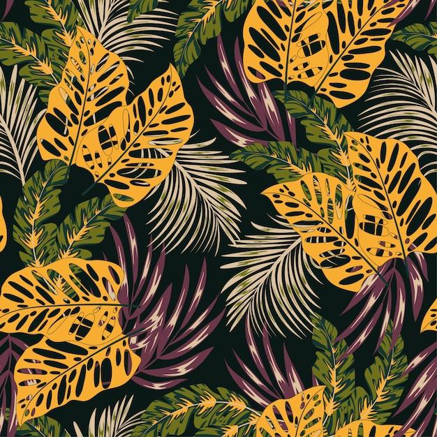 Abstrait Motif Tropical Sans Soudure Avec Des Plantes Lumineuses Et Des Feuilles Sur Une Sombre Vecteur Premium