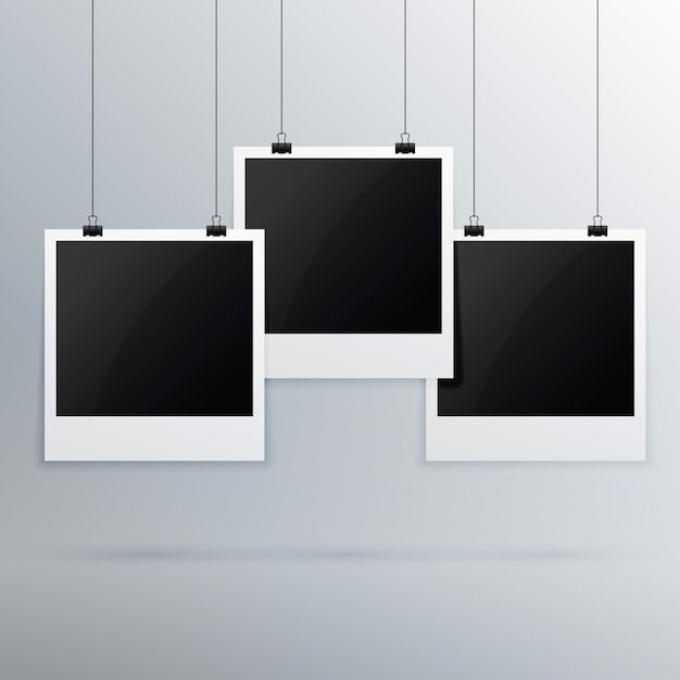accrochant cadre photo sur fond gris Vecteur gratuit