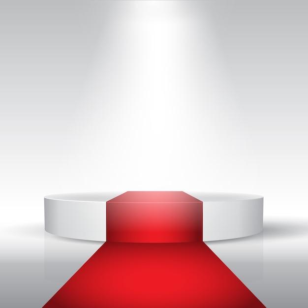 Afficher Le Podium Avec Tapis Rouge Sous Les Projecteurs Vecteur gratuit