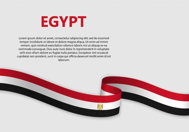 Agitant la bannière du drapeau égyptien Vecteur Premium