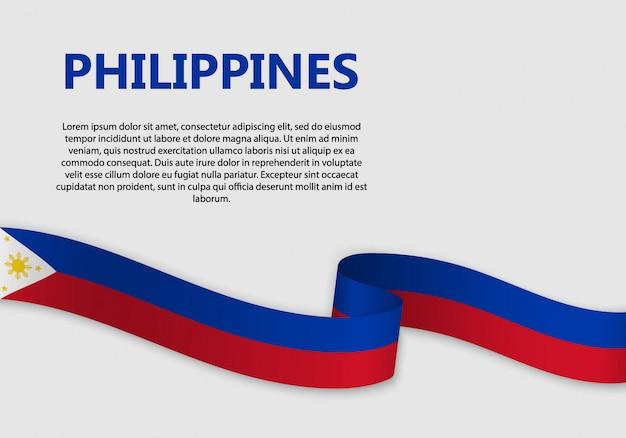 Agitant le drapeau des philippines Vecteur Premium