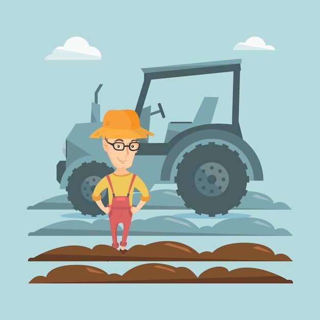 Agriculteur debout avec tracteur Vecteur Premium