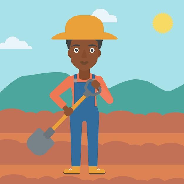 Agriculteur sur le terrain avec une pelle Vecteur Premium