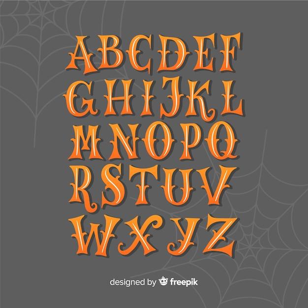 Alphabet d'halloween vintage avec toile d'araignée Vecteur gratuit
